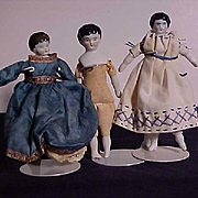 Three Miniature China And Matte Finish Dolls