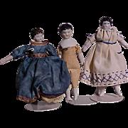 Three Miniature China And Matte Finish Dolls