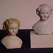 Two Molded Hair Bisque Shoulder Heads