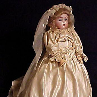 S & H, K * R Child Dressed In Antique Bridal Gown