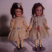 Pair Of German Bisque Dolls In Matching Dresses