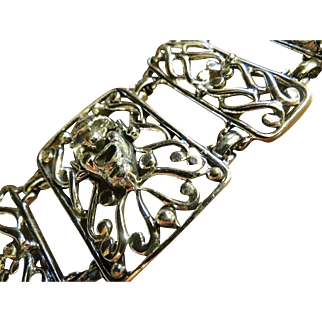 Signed Selini Abstract Modernist Chunky Bracelet with embossed clown heads
