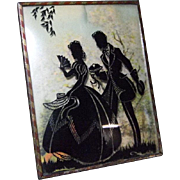 Vintage Young Couple Silhouette with Apple Blossoms Background