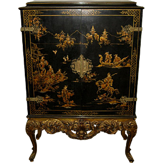 Chinoiserie Style Black and Red Lacquered Cabinet with Gilt Apron and Legs