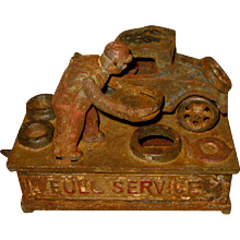 Antique Mechanical Cast Iron Bank, Signed J.E. Stevens