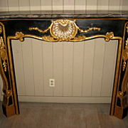 Black and Gilt Fireplace Mantle with Neoclassical Motif