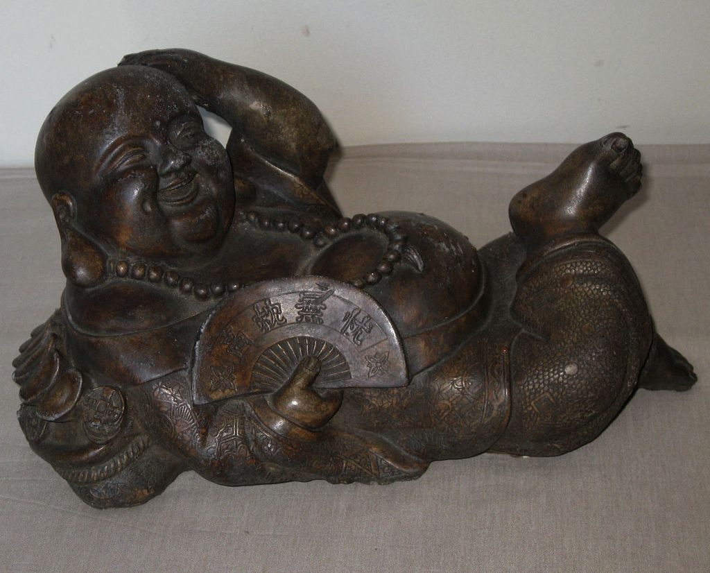 Chinese carved stone recumbent budai from