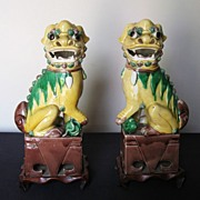 Pair of Chinese Early 20th Century Yellow Porcelain Fu Lions