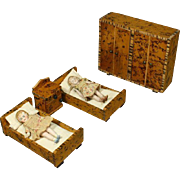 Pair of All-bisque tiny dolls in Wooden Bedroom Furniture