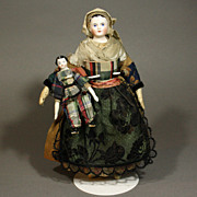 Two Early All-Original Porcelain Dollhouse Dolls - The Mother and her Son