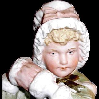 Adorable Gebruder Heubach Girl Figure Holding Muff