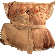 Twin German Painted Bisque Baby Dolls on Original Pillow