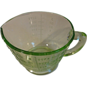 Vintage green depression 2 cup measuring cup glows with black light