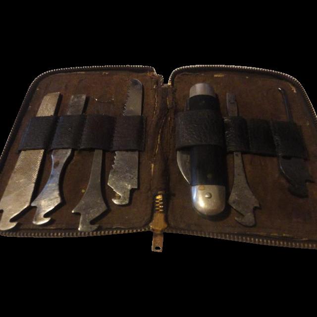 Vintage old leather cased 7 piece Utica cutlery Co. pocket knife set