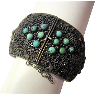Dramatic Chinese Cuff Bracelet on Silver-Toned and Japanned Metal with Filigree Work and Turquoise Stones with  a Safety Chain