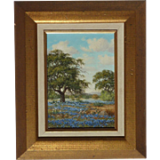 Oil on masonite painting of Texas landscape with Bluebonnet and Oak trees  signed by artist B. Cunningham