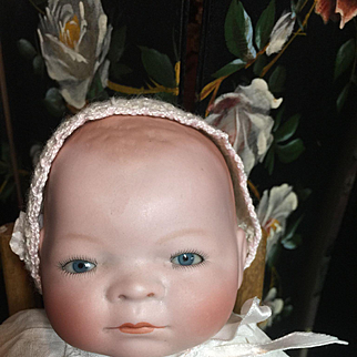 """Small 12"""" Bisque Head Bye-Lo with Tagged Dress"""