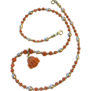 Antique Mediterranean Salmon Coral Bead Necklace with Carved Laughing Buddha Coral Pendant 14 K Gold Enhancer and 10 K Gold Beads