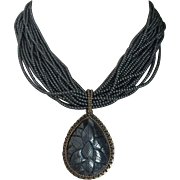 Opulent Elegant STEPHEN DWECK Necklace 20 Strands Hematite Beads with Large Carved Hematite Pendant in Bronze