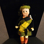 Antique Miniature Bisque Doll in Original Clothing Doll House