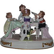 Old Children Doll Figurine Group Sitting at Table Porcelain