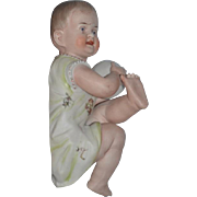 Old Piano Baby Bisque Figurine Large Playing with Ball