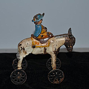 Old Doll Toy Cast Iron Horse Donkey On Wheels With A Woman Moves