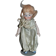 Antique Doll Miniature Dollhouse Jointed in a Silk Romper