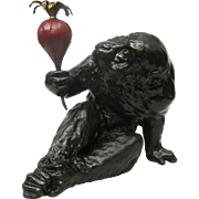 Bronze Japanese ape w/ turnip