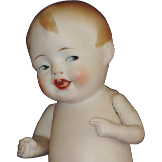 "Early 5"" All Bisque Laughing Boy with Side Glancing Eyes"