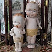 2 Nippon all bisque dolls big brother little brother with pacifier