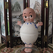 Nippon all bisque googly eyed doll in an egg 5""