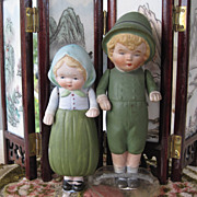 Nippon all bisque boy and girl in green outfits