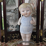 Nippon all bisque boy in blue wrap around outfit 4 1/2""