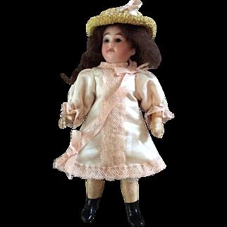 "Beautiful 7"" German bisque head doll"