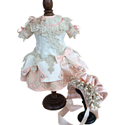 Cream and peach pink couture dress and bonnet