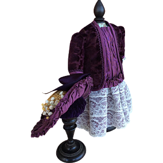 Lace and figured purple velvet dress jacket and straw hat