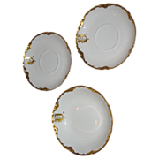 Haviland small bowl and 2 saucers. Monogrammed U and gilt (3)