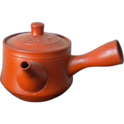 Vintage red clay teapot with bamboo design and Japan sticker