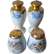 Two pairs of Japan shakers with gold tops and floral painting - One pair signed NIPPON