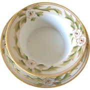 Nippon ramekin and saucer hand-painted with green leaves and red centered white flowers