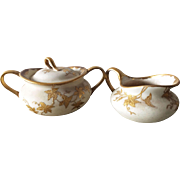 Vintage unsigned creamer & sugar bowl with lid - gold leaves design with tendrils