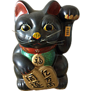 Vintage large black lucky cat maneki neko bank with left paw raised