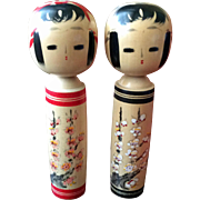 Tall kokeshi couple with blossoms