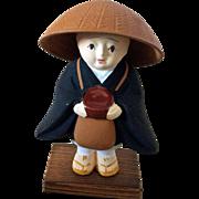 Small boy Buddhist priest monk bisque figurine on wood
