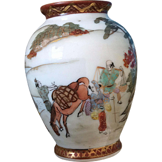 Occupied Japan mini vase urn with scenes of travelers, a horse, a lake, Mt Fuji