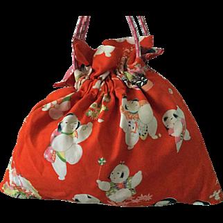 Vintage kimono fabric drawstring bag with obijime strap - orange print with babies