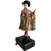 Vintage Japanese geisha dancing doll on lacquer music box