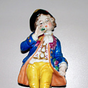 Continental Porcelain Figurine of Boy on Rococo Plinth with Roses in hand. ca. 1910  perfect