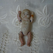 Lovely Antique All Bisque tiny baby doll movable arms and legs in straw basket